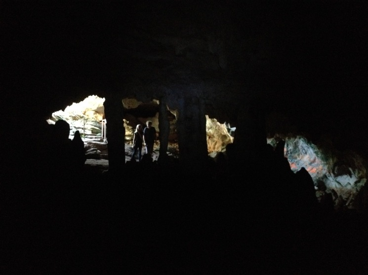 The kids ran ahead as we made our way back to the cave entrance. I am looking at them through stalactites and stalagmites.