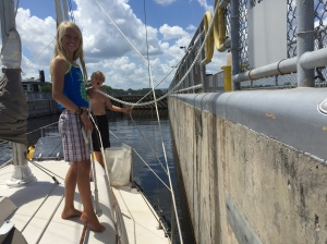 The kids handling the lines in a lock